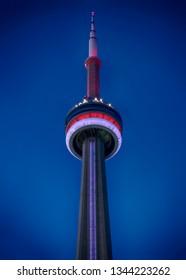 Toronto, Ontario - July 6 2018: Looking up at the Cn Tower at night.