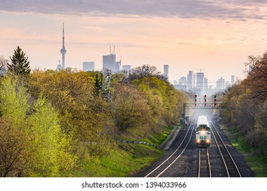 Toronto, Ontario - May 7, 2019: An eastbound GO Train approaches Danforth Station in Toronto's East End near sunset.
