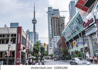 TORONTO, ONTARIO - SEPTEMBER 5: Street view of downtown Toronto, in Toronto, ON, on September 5, 2013. Toronto is the 5th largest city in North America, behind NYC, LA, Chicago, and Mexico City.