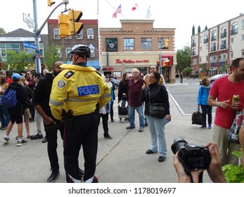 Toronto, Ontario/Canada - 09/09/2018: Police telling a peaceful protestor to step back from anti-Muslim activist, Iola Fortino, at Danforth United Against Hate rally.