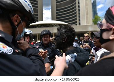 TORONTO, ONTARIO/CANADA – 6th Saturday June 2020 : A man who appeared at Nathan Phillips Square at the start of the protest wearing blackface was escorted out of the public square by Toronto police