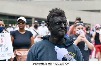 TORONTO, ONTARIO/CANADA – 6th Saturday June 2020 : A man who appeared at Nathan Phillips Square at the start of the protest wearing blackface was escorted out of the public square by Toronto police o