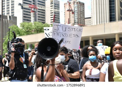 TORONTO, ONTARIO/CANADA – 6th Saturday June 2020 : Thousands of people took to Toronto streets in separate events to protest anti-black racism and police brutality on Saturday.