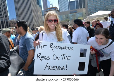 TORONTO, ONTARIO/CANADA - 6th Wednesday May 2015 : Toronto Uber pushes campaign for regulation at Nathan Phillips Square on 6th May 2015.