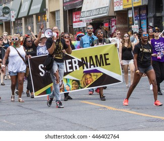 Toronto, Ontario/Canada   July 2, 2016: The Toronto 2016 Dyke March paraded its way down Yonge Street today led by the Black Lives Matter Toronto Coalition.  Pride month concludes on July 3, 2016.