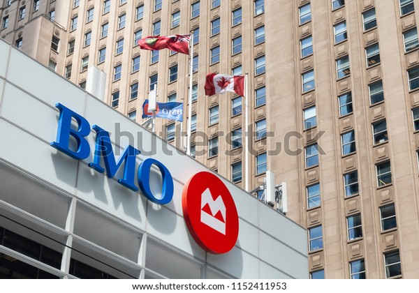 Toronto, Ontario/Canada - July 20 2018: Bank of Montreal BMO Head Office Building Flags King Street