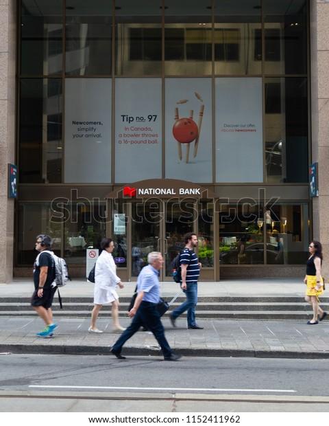 Toronto, Ontario/Canada - July 20 2018: National Bank Head Office Toronto People Walking By Sign Signage Logo Sidewalk