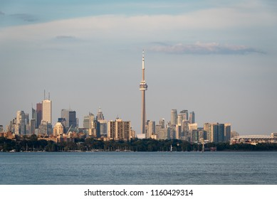 TORONTO, ONTARIO/CANADA - JULY 25, 2018: A view of the Toronto downtown skyline after sunset, taken from Humber Bay, on Lake Ontario.
