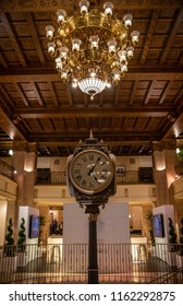TORONTO, ONTARIO/CANADA - JULY 25, 2018: A view of the clock, chandelier and hand carved wooden coffered ceiling found in the lobby of the Fairmont Royal York Hotel in downtown Toronto.