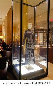 TORONTO ONTARIO/CANADA NOVEMBER 18 2017 The Haute Couture Dress by Alexander McQueen designer dress in a glass case inside The Bar of the Shangri La hotel in Toronto, Canada