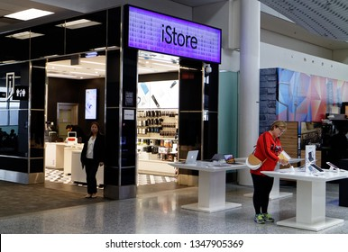 TORONTO ONTARIO/CANADA NOVEMBER 18 2018 A woman looking at  an iPad at the Apple iStore in Toronto Pearson Airport
