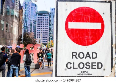 Toronto, Ontario/Canada - September 5 2019: Road closure signs for the Toronto International Film Festival (TIFF), at King St, and University Ave. with background in soft focus.