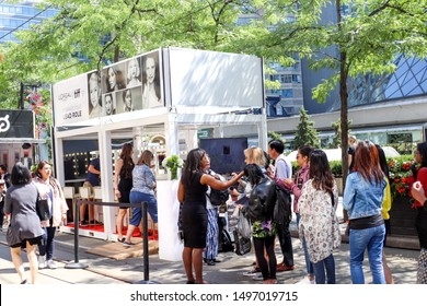 Toronto, Ontario/Canada - September 5 2019: Locals and tourists line up to enjoy various booths on King Street on opening day at the Toronto International Film Festival (TIFF).