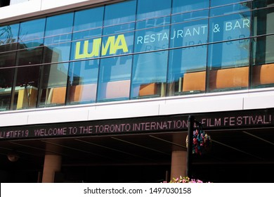 Toronto, Ontario/Canada - September 5 2019:  Well-known restaurant Luma and the TIFF Bell Lightbox on King Street welcome visitors on opening day at the Toronto International Film Festival (TIFF).
