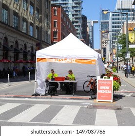 Toronto, Ontario/Canada - September 5 2019: Medical staff at first aid tent on King Street on opening day at the Toronto International Film Festival (TIFF).