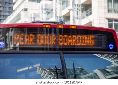 Toronto Public Transportation during Covid-19 pandemic. Rear door boarding rule rules implemented to limit social distancing.