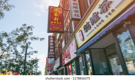 TORONTO - SEP 12, 2018: Chinese signs for business in the China town area of Toronto along Spadina.