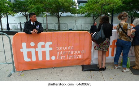 TORONTO - SEPTEMBER 13: Spectators and guards gather at entrance of Roy Thomson Hall for star spotting at the 36th Toronto International Film Festival Sept 13, 2011 in Toronto, Canada