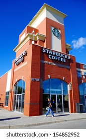 TORONTO - SEPTEMBER 14: A retail outlet for Starbucks on September 14, 2013 in Toronto. Starbucks has 18,000 stores in 60 countries.