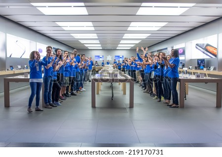 TORONTO - SEPTEMBER 19: Apple staffs cheer at the Apple Store, Eaton Centre in Toronto, Canada on September 19, 2014. Apple's newest iPhones, the 6 and the 6 Plus go on sale this day.