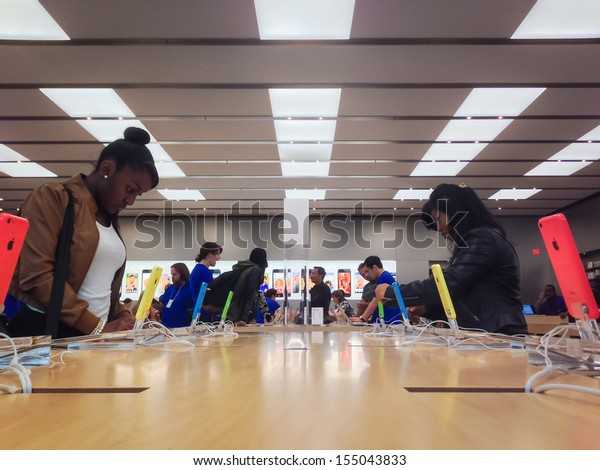 TORONTO - SEPTEMBER 20: Customers browse the Apple Store in Toronto, Canada on September 20, 2013. Apple's newest iPhones, the 5C and the 5S go on sale across Canada this day.