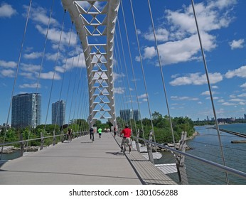TORONTO - SEPTEMBER 2016:  Toronto's Waterfront recreational trail is popular with cyclists and joggers, here crossing a bridge over the Humber River.