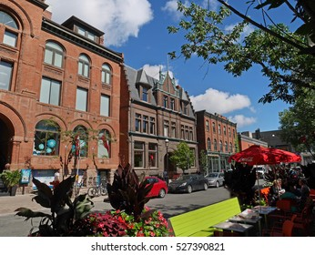 TORONTO - SEPTEMBER 2016:  Tucked away among the high rises, Elm Street preserves fine old Victorian buildings and has outdoor restaurants, as seen in Toronto circa 2016.