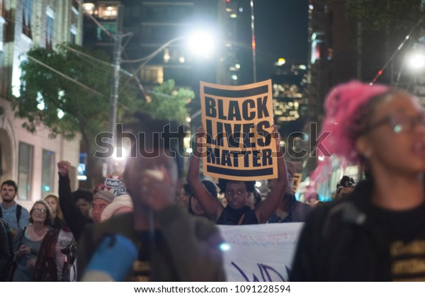 TORONTO - SEPTEMBER 25: People marching on the streets during a rally to speak about the plurality of violence and anti-Black racism in Toronto, Canada, on September 27, 2015.