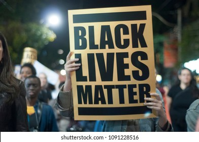 "TORONTO - SEPTEMBER 25: People waiving ""black lives matter"" signs during a rally to speak about the plurality of violence and anti-Black racism in Toronto, Canada, on September 27, 2015."
