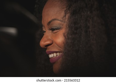 Toronto - September 6, 2014: Canadian singer/songwriter Jully Black at The Giorgio Armani Films of City Frames Cocktail Party Black Carpet at CN Tower, TIFF 2014.