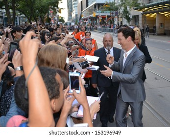 TORONTO - SEPTEMBER 6: Actor Benedict Cumberbatch signs autographs at the Toronto International Film Festival for his new film 12 Years a Slave on September 6, 2013.