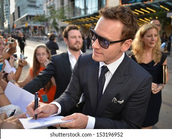 TORONTO - SEPTEMBER 6: Actor Michael Fassbender signs autograph at the Toronto International Film Festival for his new film 12 Years a Slave on September 6, 2013.