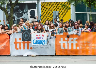 Toronto - September 9, 2014: Fans of Benedict Cumberbatch pose and show off their tributes to the actor at the premiere of The Imitation Game at TIFF 2014.