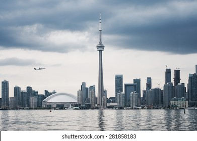 Toronto skyline with airplane
