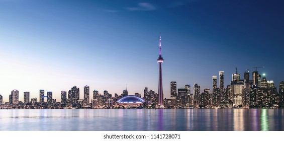 Toronto skyline at night with faded effect.