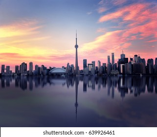 Toronto Skyline at night with a reflection in Lake Ontario, Ontario, Canada