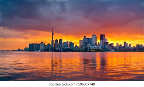 The Toronto skyline as the sun sets behind it