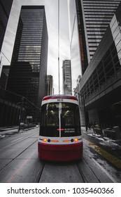 TORONTO STREETCAR - Modern transit vehicle driving through downtown city core. Urban landscape with public transportation. Toronto, Ontario, Canada