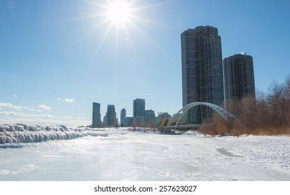 Toronto West Winter Humber Bridge. Frozen waves of ice from Lake Ontario on the breakers in west Toronto, at the Humber River Arch Bridge.
