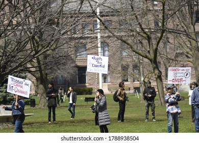 TORONTO-APRIL 25:Anti lock down protesters with signs asking to reopen during a rally to protest provincial and federal shut down to control the spread of Covid-19 on April 25, 2020 in Toronto,Canada
