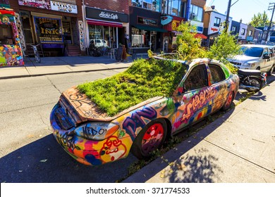 TORONTO,CANADA 16-10-2015:Graffiti Car in front of Big Fat Burrito restaurant in the Pedestrian Sundays celebration in Kensington Market. Kensington Market is a distinctive multicultural neighborhood