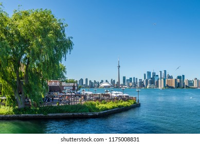 TORONTO,CANADA - JUNE 25,2018 - View at the Toronto downtown from Toronto Islands on Ontario lake. Toronto is the capital city of the province of Ontario and the largest city in Canada.