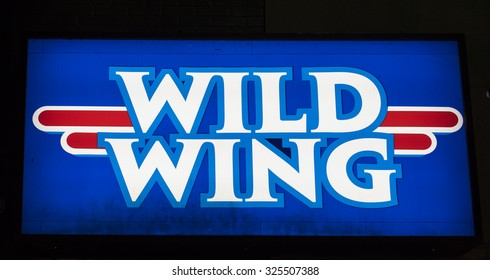 TORONTO,CANADA-AUGUST 12,2015: Signage of Wild Wing restaurant. Wild Wing Restaurants is a Canadian franchised restaurant chain that specializes in chicken wings