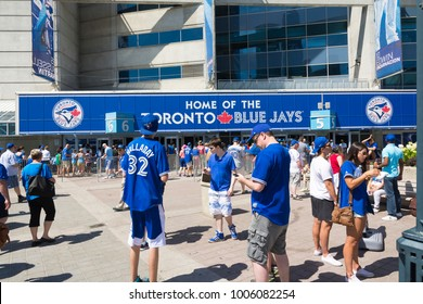 Toronto,Canada-august 2,2015:Blue jays fans waiting to enter the Toronto stadium Roger center to watch the baseball game on a sunny day