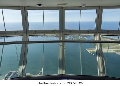 TORONTO,CANADA-AUGUST 2,2015:panoramic windows on the top of Cn tower during a sunny day.