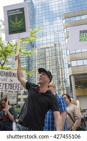 TORONTO,CANADA-MAY 27,2016:Marihuana supporters protesting Project Claudia outside Toronto Police Headquarters.Project Claudia was a crack down on pot dispensaries by Toronto police