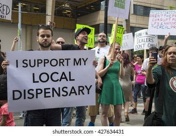 TORONTO,CANADA-MAY 27,2016:Pot activists protest Project Claudia at Police Headquarters. Project Claudia was a crack down on pot dispensaries by Toronto police leaving 90 about 90 arrests and charges.