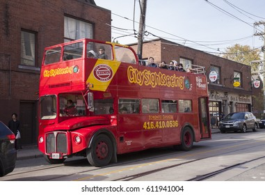 TORONTO,CANADA-NOVEMBER 201,2016: Red double decker tour bus and several people on the bus enjoying the famous sights of Toronto.