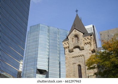 TORONTO,CANADA-NOVEMBER 20,2016:TORONTO,CANADA-NOVEMBER 20, 2016: St Andrew's Presbyterian Church and CN Tower - Toronto, Ontario, Canada