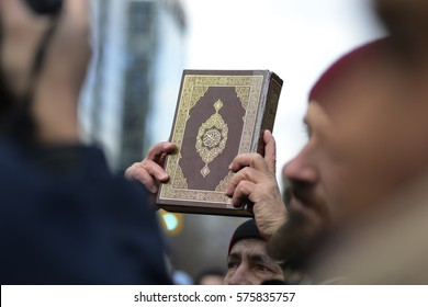 "TORONTO-FEBRUARY 4:A Muslim man holding up the holy book of ""quran"" during a protest in front of the US Consulate to denounce Donald Trump's immigration policies on February  4,2017 in Toronto,Canada."